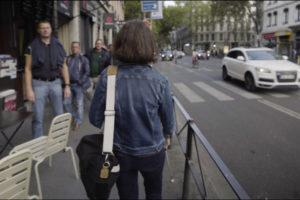 Lise, visually impaired person, walking in the street