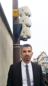 Benjamin Charles from the RATP in front of traffic lights equipped with our device aBeacon