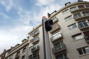 Our audio signage system installed on a pole at a bus rapid transit intersection to compensate for the removal of accessible pedestrian signals